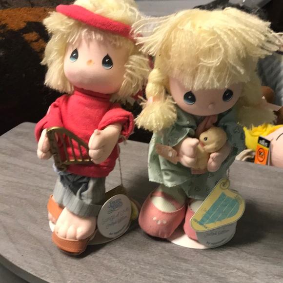 Two precious moments dolls